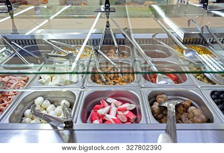 Fresh Salad Bar With Various Fresh Assortment Of Ingredients. Display Space Of Options For Choice Of