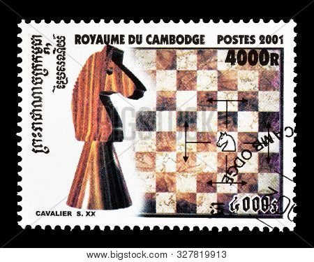 Cancelled Postage Stamp Printed By Cambodia, That Shows Chess Figure Knight, Circa 1991.