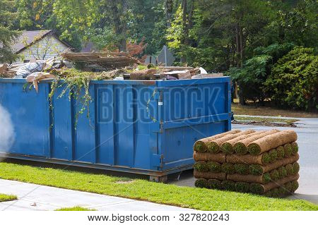 Lawn Grass In Rolls On Pallets Against Of The Street The Rolled Grass Lawn Ready For Laying And Load