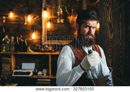 Serious Barman. Restaurant Staff. Bearded Hipster Wear Waistcoat. Pub Retro Vintage Interior. Barman