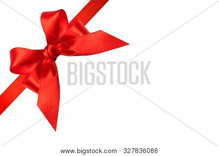 Red Ribbon With Bow Isolated On White Background. Holiday Christmas Ribbon With Bow As Design Elemen