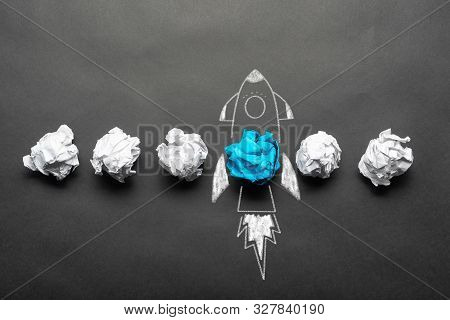 Rocket Sketch Drawing With Crumpled Blue Paper Ball On Chalkboard. Successful Business Startup. Crea