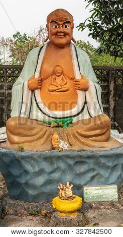 Bang Saen, Thailand - March 16, 2019: Wang Saensuk Buddhist Monastery. Colorful Statue Of Pra Asito,