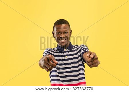 Happy Young African-american Man Pointing At Viewer Isolated On Yellow Studio Background, Facial Exp