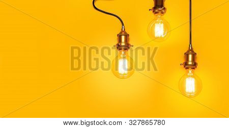 Vintage Fashionable Edison Lamp On Bright Yellow Background. Top View Flat Lay Copy Space. Creative