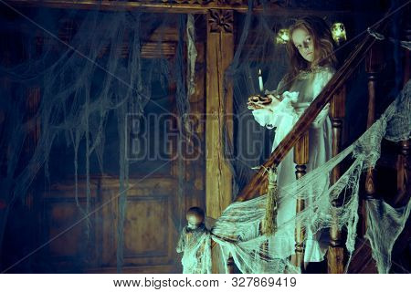 Halloween. A ghost girl in a nightgown wanders through the old house at night.