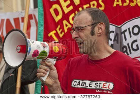 Mike Gurney speaking at Exeter Cathedral Yard as part of the May Day rally