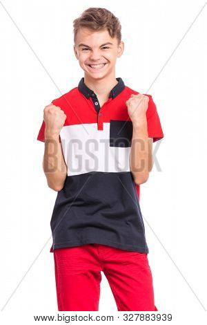Portrait of happy teen boy showing winning gesture. Successful and celebrating victory, triumphant child making win sign. Handsome caucasian young teenager, isolated on white background.
