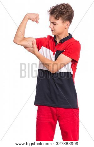 Portrait of funny teen boy raised his hands and shows biceps, isolated on white background. Handsome teenage young boy shows biceps. Happy strong child flexing biceps.
