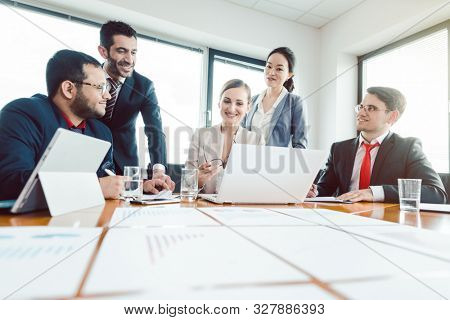 Team of international office workers discussing business development