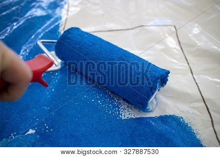 Paint Roller With Blue Paint On Plastic Foil - Preparation Of A Football Choreography By Supporters