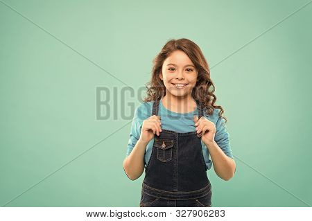 Shes Got A Pretty Smile. Little Girl With Cute Smile On Blue Background. Smiling Kid With White Heal