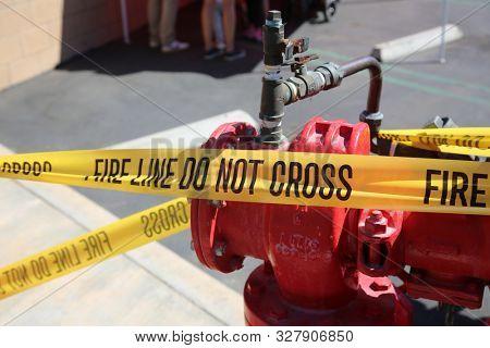 FIRE LINE - DO NOT CROSS. Fire Department Yellow Caution Tape. Warning Tape. Fire Line tape. Fire Department Warning. Work Site. Emergency Site. Do not enter.