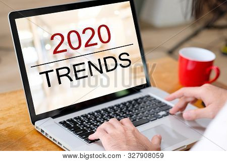 2020 Digital Trends, Man Hand Tying Laptop Computer With 2020 Trends On Screen Background, Digital M