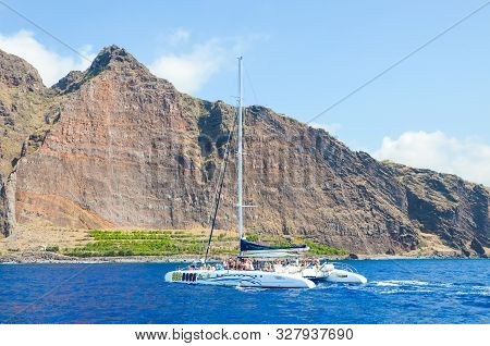 Madeira, Portugal - Sep 10, 2019: Tourist Sightseeing Boat With People In The Waters Of The Atlantic