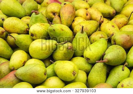 Fresh Pears Food Closeup. Healthy Food. Vegetarian Food. Nutritious Food. Green Pears On Food Market