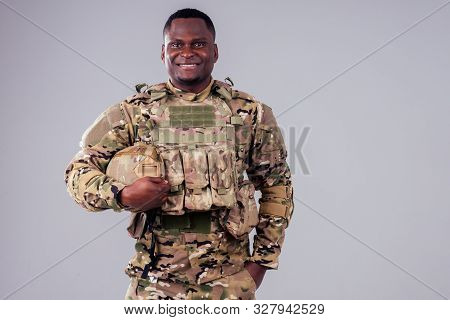 African American Soldier With Folded Arms Standing In White Studio