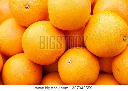 Oranges On Market Stall. Bunch Of Bright Color Oranges. Texture Background Ripe Juicy Fruits Oranges