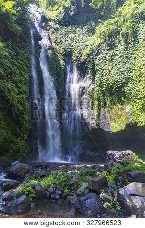 Sekumpul Waterfalls In Bali, Indonesia.waterfall In Green Forest. Triple Tropical Waterfall Sekumpul