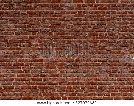 Terracotta Brick Wall Background Texture. Background Of Old Vintage Red Brick Wall. Grunge Red Brick