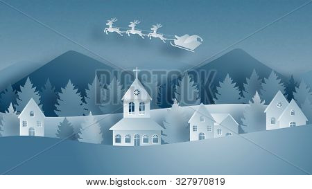 Winter Landscape With Santa Claus On Sleigh And Reindeer Flying Over Village On Snowfield In Paper C