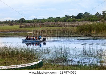 Group of tourists in a boat in Okavango Delta, in Kasane and Maun Botswana