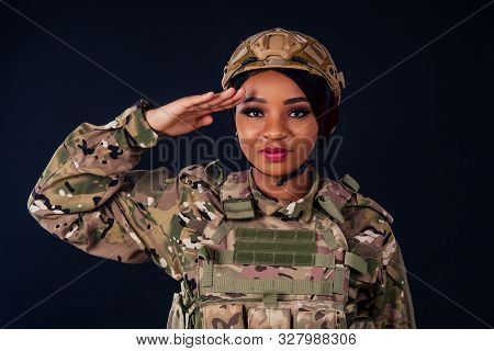 Young Latin Indian Woman Soldier With Gun Studio Black Background