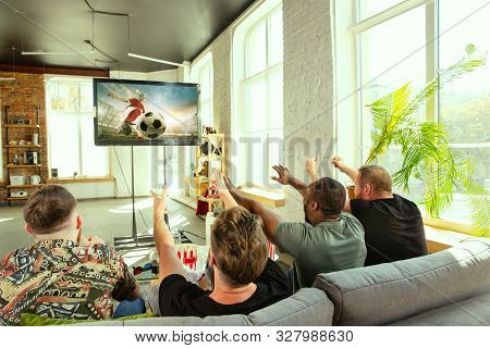 Group Of Friends Watching Game On Tv At Home. Sport Fans Spending Time And Having Fun Together. Emot