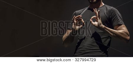 Sign Language Man Interpreter Gestures Over Stage During Public Event. Empty Copy Space For Editor C
