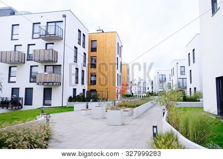 Sidewalk In A Cozy Courtyard Of Modern Apartment Buildings Condo With White Walls. No People.  Real