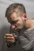 male alcoholism. drinking father, a man drinks vodka. feeling unwell. assault, booze at home. stop alcohol. poster
