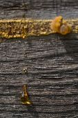 drops of resin on old wooden wall poster