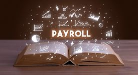 PAYROLL inscription coming out from an open book, business concept
