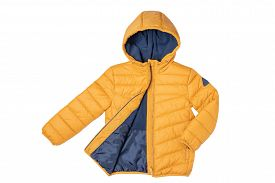 Childrens Winter Jacket. Stylish Childrens Yellow Warm Down Jacket Isolated On White Background. Win