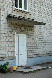 Entrance To A Brick Building With A White Door