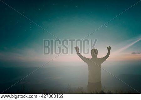 Happy Man Rise Hand Worship God In Morning View. Christian Spirit Prayer Praise On Good Friday Backg