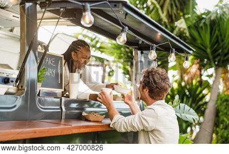 Afro Food Truck Owner Serving Meal To Male Customer - Modern Business And Take Away Concept