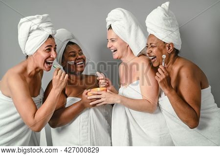 Happy Multiracial Women With Different Age And Body Size Having Skin Care Spa Day - People Selfcare