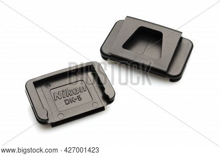 Carrara, Italy - July 17, 2021 - Nikon Dk-5 Eyepiece Cap Front And Rear View On White Background
