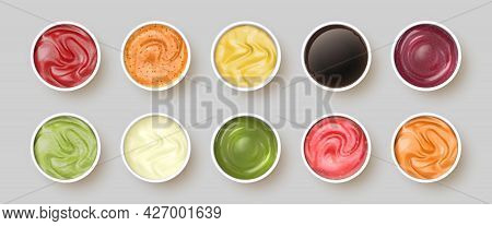 Dip Sauces Top View. Bowls With Mayonnaise, Tomato Ketchup, Mustard, Pesto, Curry And Guacamole. Rea