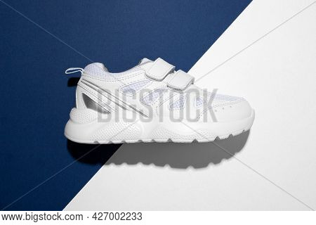 Top View Macro On One White Teen Sneaker On The Side With Velcro Fasteners For Easy Footwear On A Tr