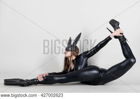 Sexy Beautiful Woman Pole Dancer Posing In Latex Costume On Background. Easter Bunny Concept.