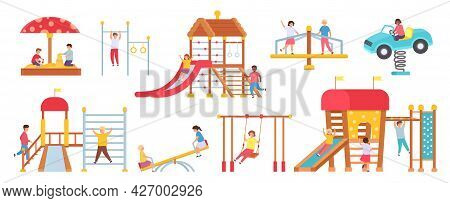 Children At Playground Equipment. Boys And Girls Playing In Play House. Kids On Swings, Slide, Carou