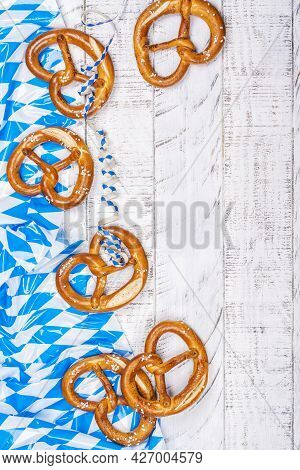 Freshly Baked Homemade Soft Pretzel With Salt On White Wooden Table Covered Traditional Blue And Whi