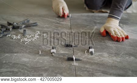 Plastic Cross For Leveling Tiles During Construction Or Renovation. Floor Tile Repair. Installation