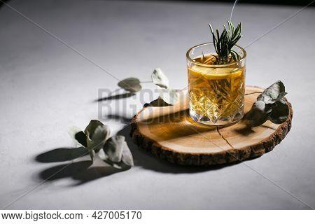 Yellow Cocktail On The Wooden Podium Eucalyptus Rosemary Dark Moody