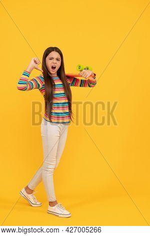 Unhappy Kid Skateboarder Point Finger On Penny Board Skateboard, Pennyboard