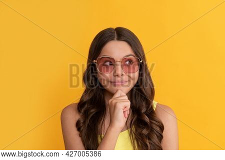 Happy Dreamy Kid In Summer Glasses Has Curly Hair On Yellow Background, Hairstyle