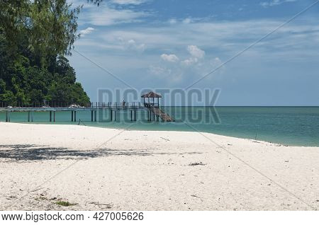 A Pier Leading Out Into The Straits Of Malacca At Kerachut Beach Within The Penang National Park In