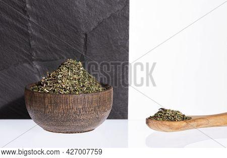 Dried Organic Tarragon Leaves In Wooden Bowl - Artemisia Dracunculus